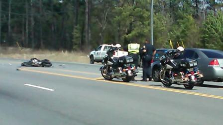 Police investigate a motorcycle crash in Durham Wednesday.