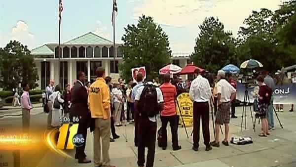 NAACP holds protest over new budget