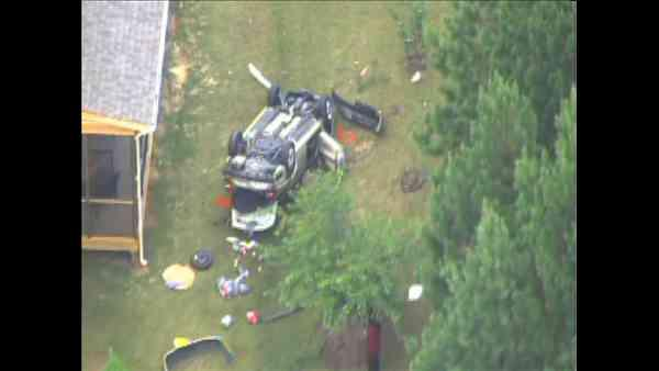 Part of Davis Drive in Cary had to be closed Thursday after a vehicle ran off the road and landed upside down in a backyard