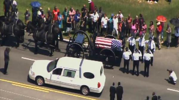Massive turnout for slain officer's funeral