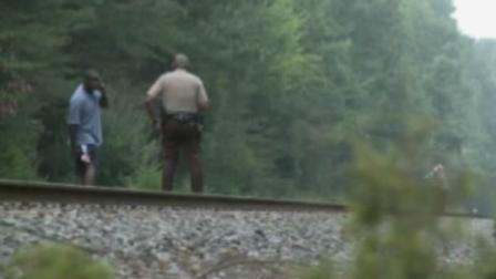 Officials investigate after a man was hit by a train early Wednesday.