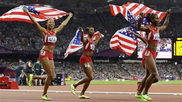 Allyson Felix, Carmelita Jeter, Bianca Knight, and Tianna Madison celebrate their gold medal win during the athletics in the Olympic Stadium