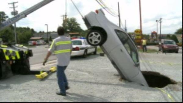 Sinkhole swallows car in Durham