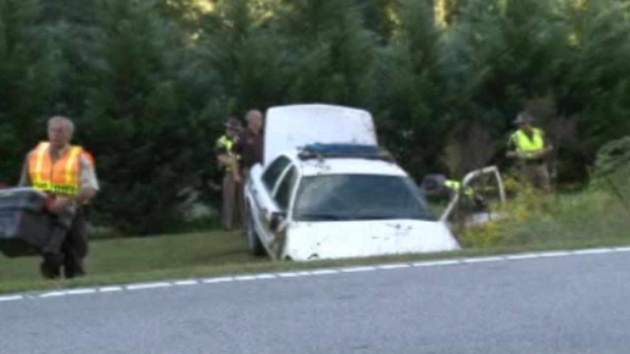 The officers patrol car flipped several times and went down an embankment along Red Mountain Road near Hampton Road.