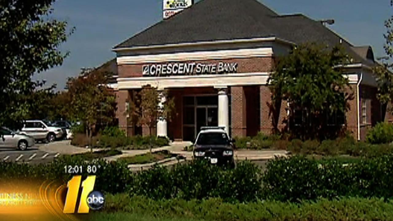 Police investigate at the Crescent State Bank in Sanford.