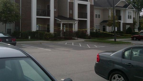 Crime tape up in front of a building at the Abberly Place Apartment Homes in the 500 block of Abberly Crest Boulevard.
