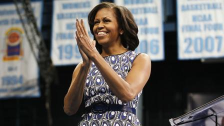 First lady Michelle Obama smiles as she greets supporters before her speech in Chapel Hill, N.C., Tuesday, Oct. 16, 2012. (AP Photo/Gerry Broome)