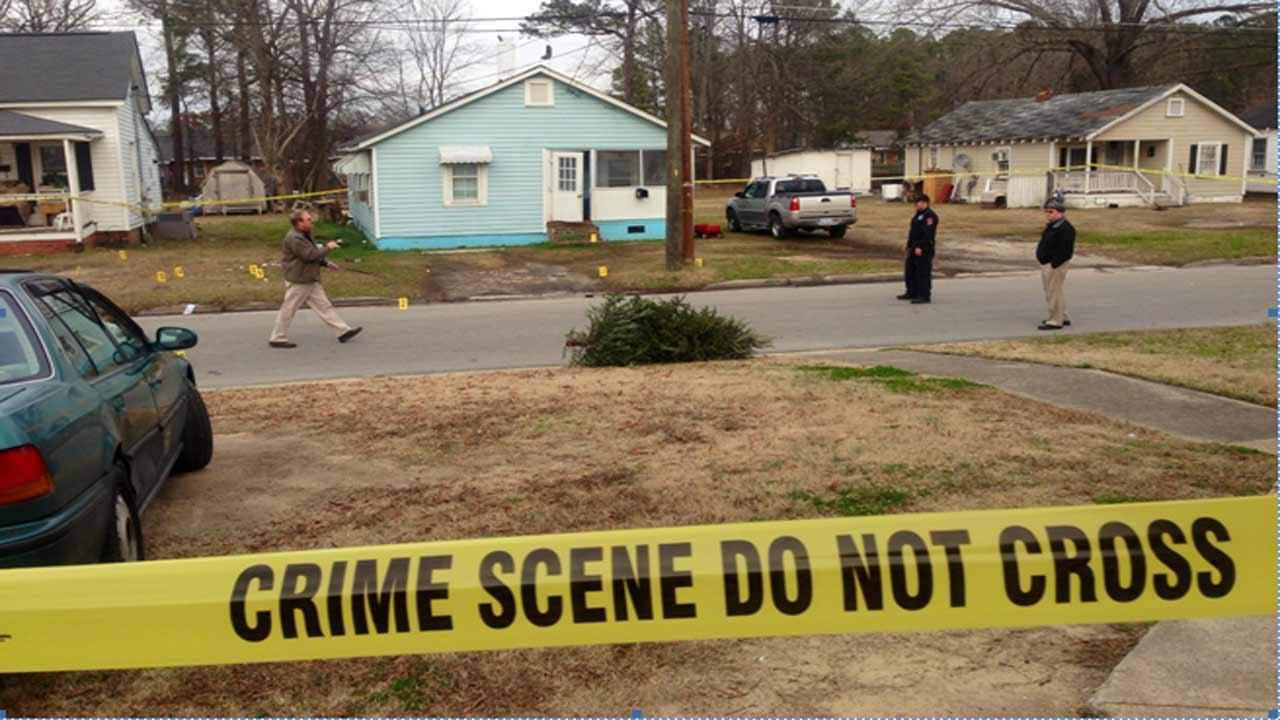 Police investigate a shooting on Mill Street in Smithfield.