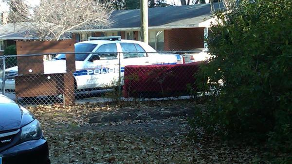 Police investigate at the scene of a shooting Thursday morning.