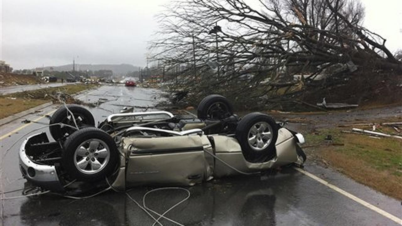 A vehicle lies on a road after a tornado moved through Adairsville, Ga. on Wednesday, Jan. 30, 2013. <span class=meta>(David Goldman)</span>