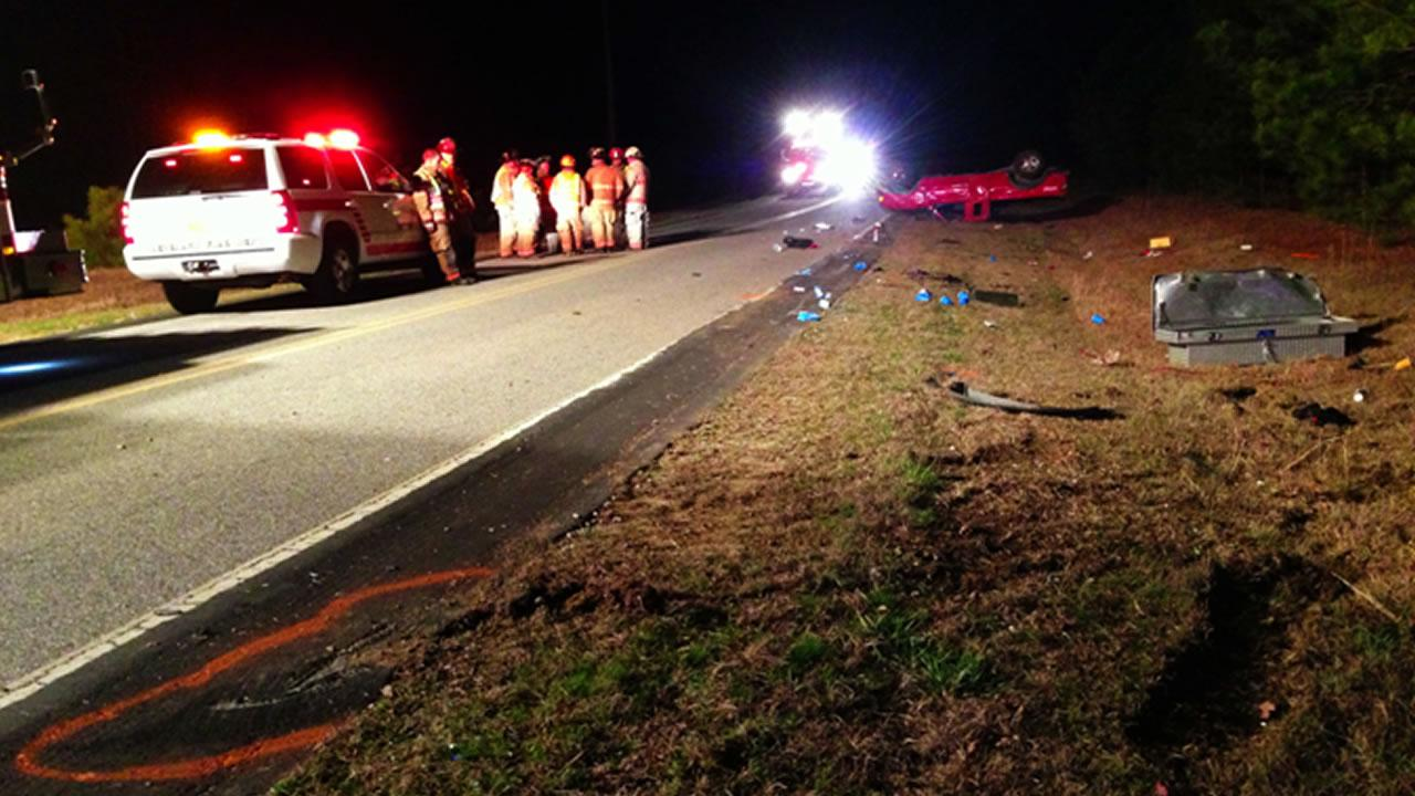 The red pickup truck rolled over in the shoulder of the road. <span class=meta>(Carter Rabil)</span>