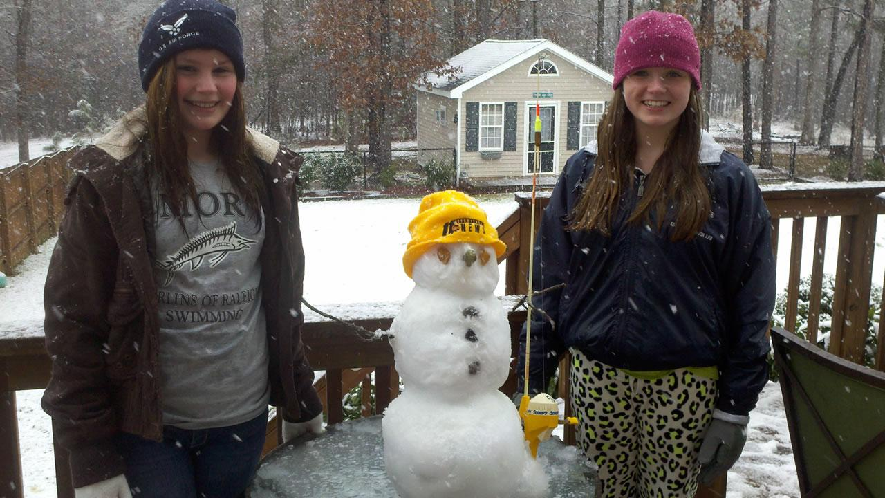 Savannah and Paige from Archer Lodge Middle School with their ABC11 snowman.