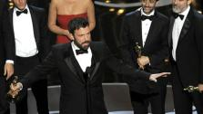 Director/producer Ben Affleck, center, accepts the award for best picture for Argo, as the cast and crew look on during the Oscars at the Dolby Theatre on Sunday Feb. 24, 2013, in Los Angeles. (Photo by Chris Pizzello/Invision/AP)