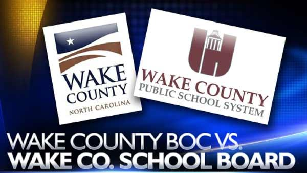 Commissioners make case for taking over school construction
