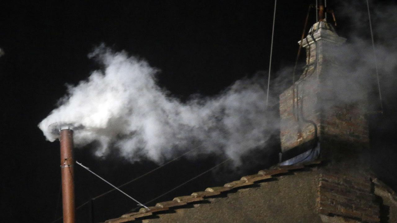 White smoke emerges from the chimney on the roof of the Sistine Chapel, in St. Peters Square at the Vatican, Wednesday, March 13, 2013. The white smoke indicates that the new pope has been elected. <span class=meta>(Gregorio Borgia)</span>