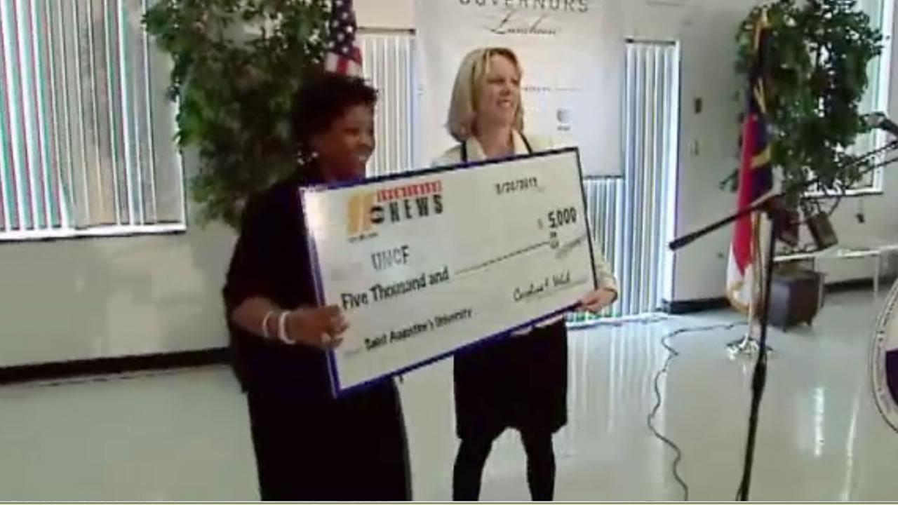 ABC11 General Manager Caroline Welch presents UNCF with a check for $5,000