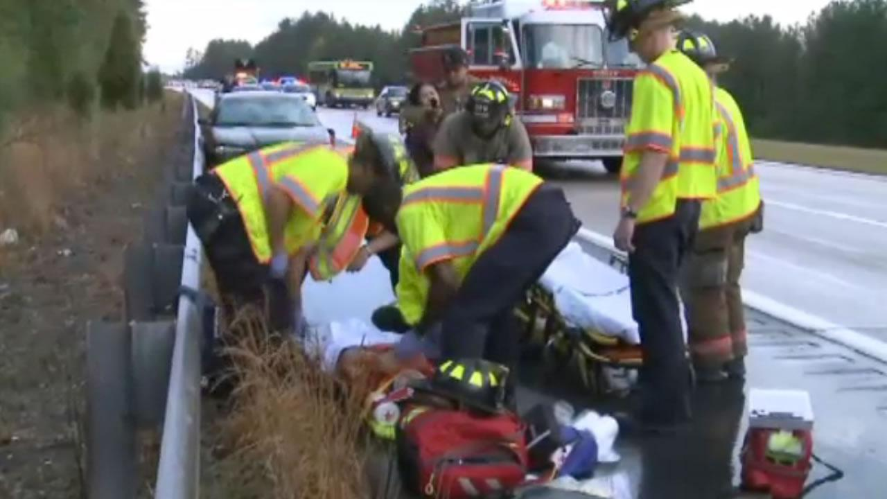 Emergency workers help a hit and run victim on Highway 147 in Durham Friday morning.