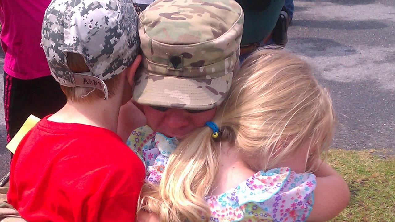 A member of the 514th Military Police Company gets a warm welcome home.