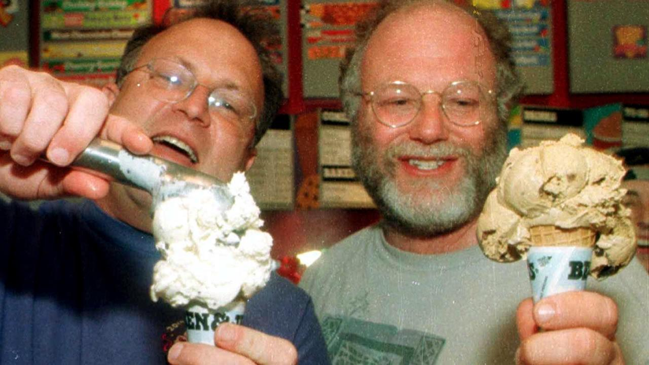 Jerry Greenfield (L) and Ben Cohen serve Ben and Jerrys ice cream
