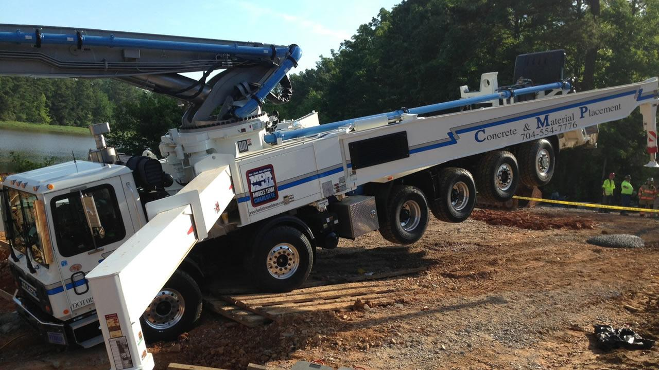 A concrete pumping truck toppled forward at a work site in Cary. <span class=meta>(Anthony Wilson)</span>