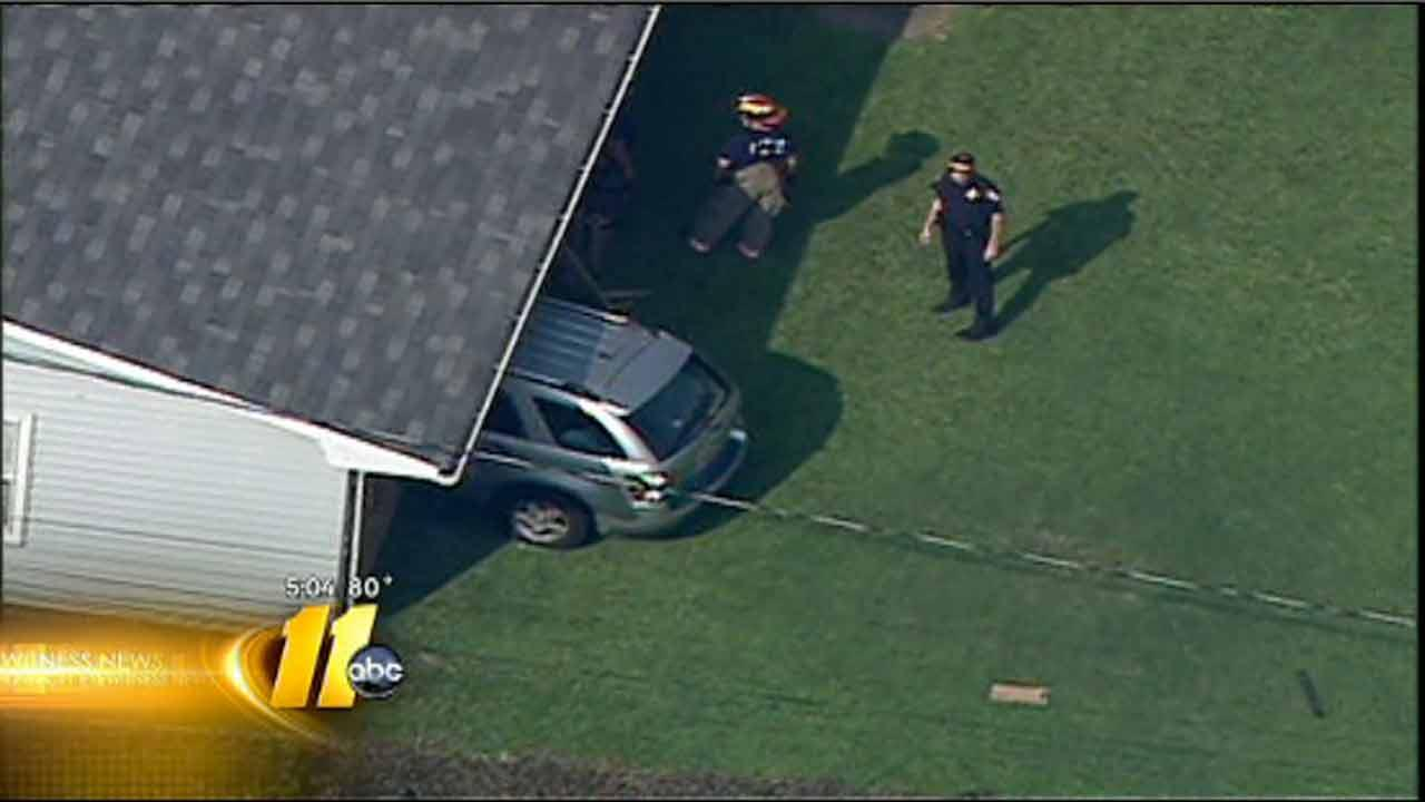 Minivan crashes into Durham home