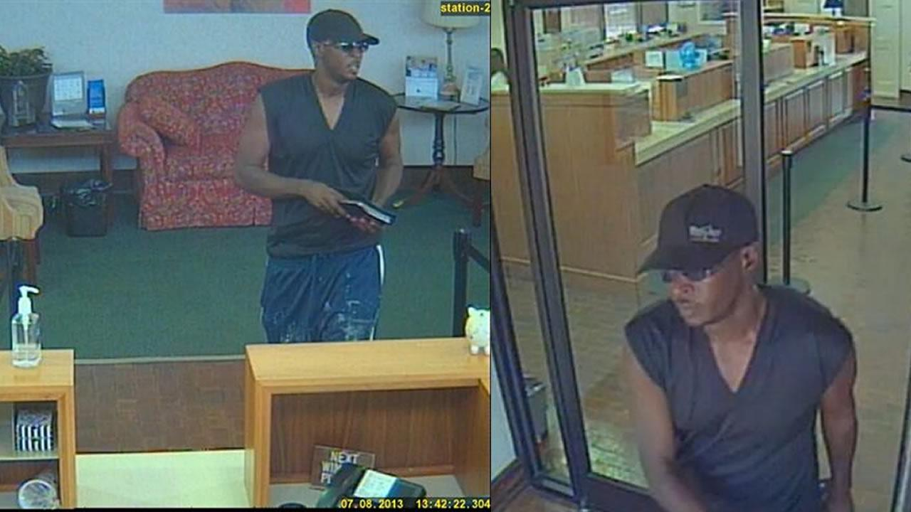 A surveillance photo from First Citizens Bank shows the man approaching the teller with a note demanding money around 1:30 p.m.