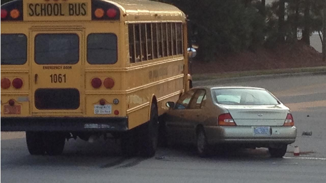 A car ended up wedged under the side of the school bus in this crash Tuesday morning. <span class=meta>(Jeff Hinkle)</span>