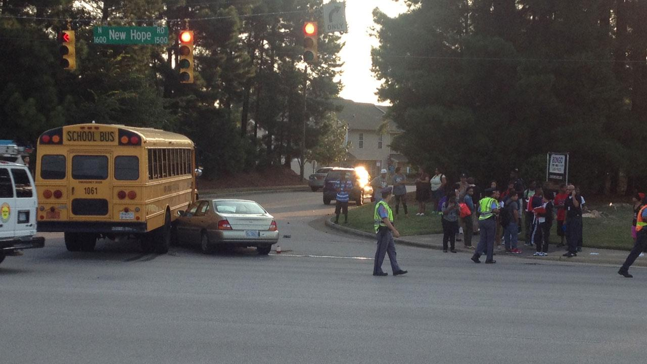A car ended up wedged under the side of the school bus in this crash Tuesday morning.ABC11 Photojournalist Jeff Hinkle