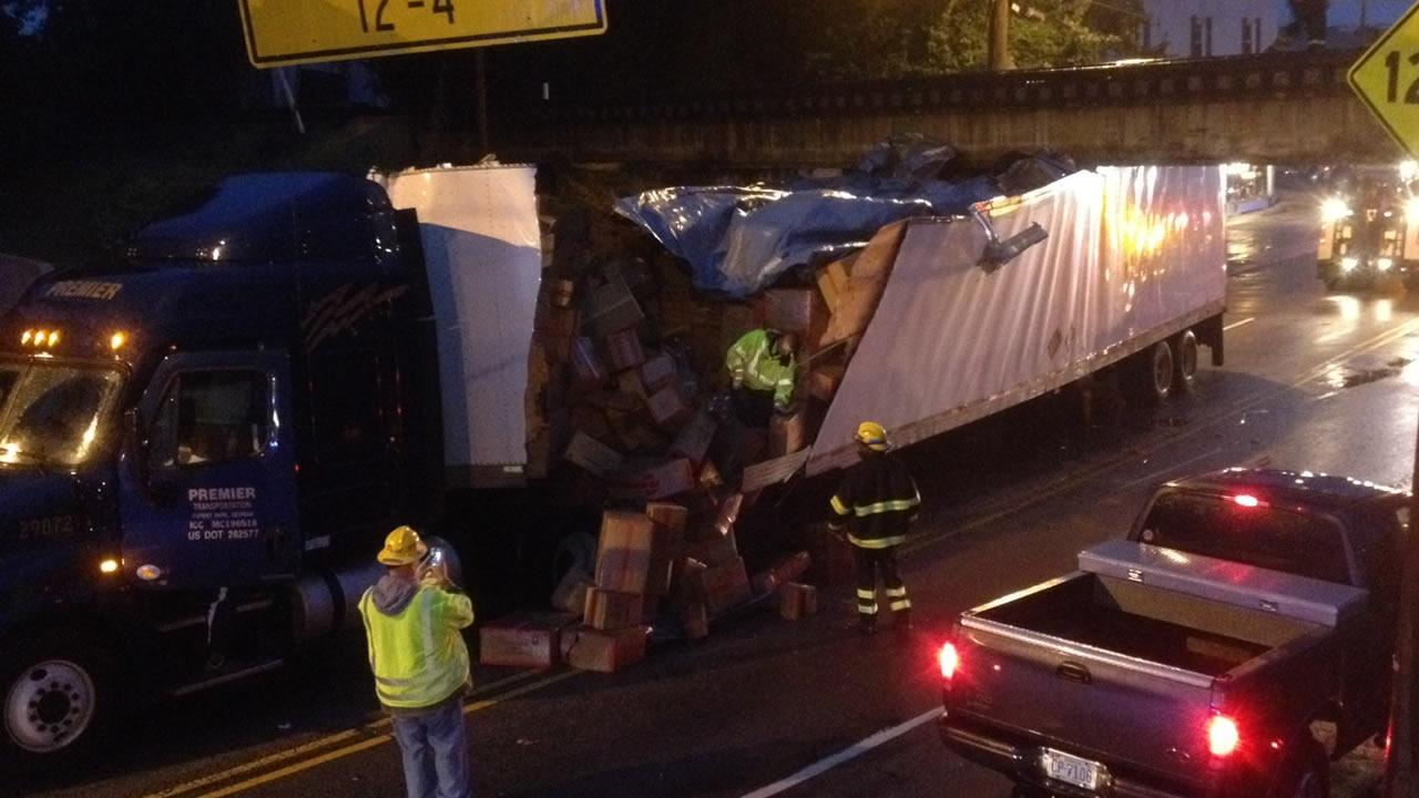 Tractor-trailer truck wedged under the Peace Street railroad bridge (WTVD Photo/Jim Schumacher)