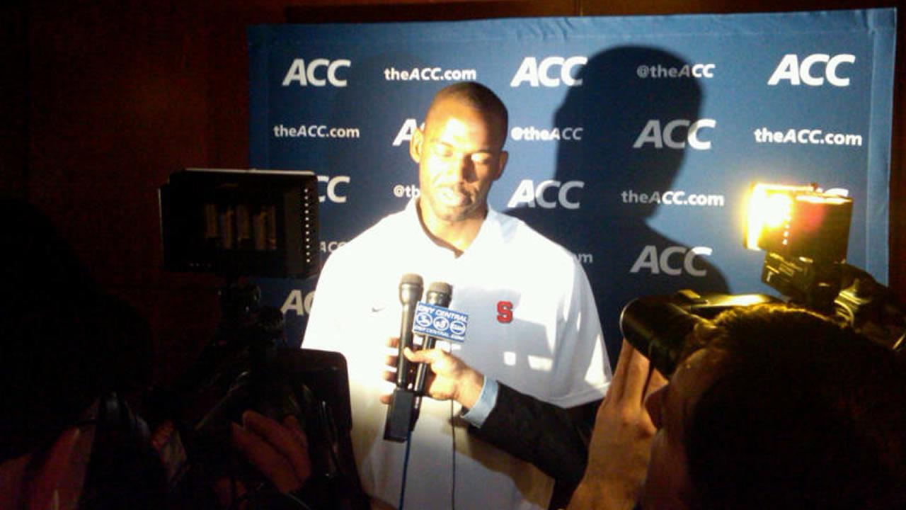 Syracuse player interviewed by TV media (WTVD Photo/ Charlie Mickens)