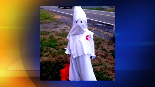 Child dresses as KKK member for Halloween