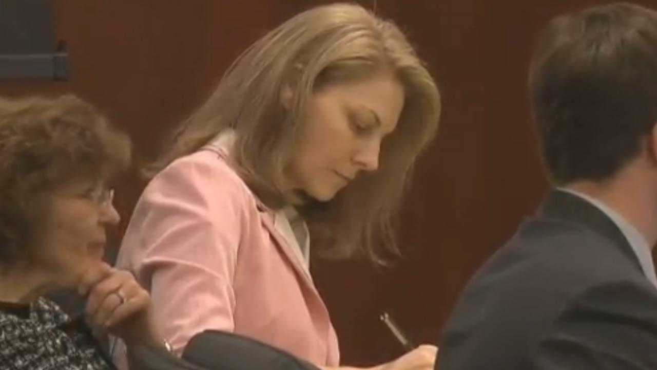 Amanda Hayes listens to testimony.