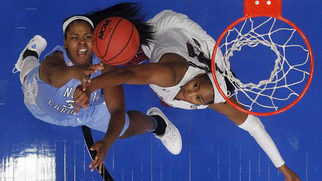 North Carolina forward Xylina McDaniel, left, shoots over South Carolina center Alaina Coates during the second half of a regional semifinal at the NCAA college basketball tournament in Stanford, Calif., Sunday, March 30, 2014.