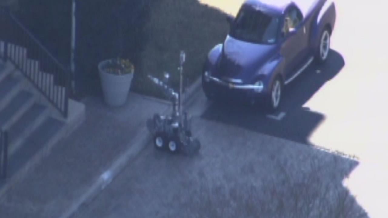 A bomb squad robot examines a suspicious object in Durham.