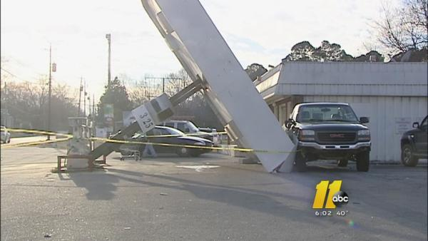 High winds damage gas station