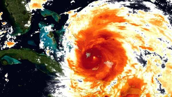 An image provided by NOAA is an infrared colorized view of Hurricane Irene as it advances towards the East Coast was made by the GOES satellite Wednesday Aug. 24, 2011