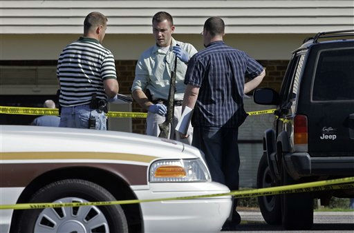 Investigators examine a weapon at the scene where a gunman opened fire at a nursing home killing at least six people and wounding several others in Carthage, N.C. on Sunday, March 29, 2009.  <span class=meta>(AP Photo&#47; Gerry Broome)</span>