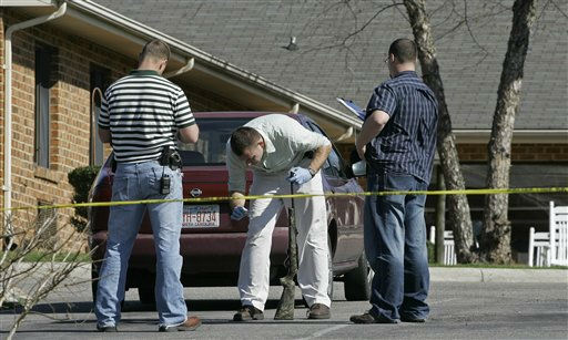 Investigators examine a weapon at the scene where a gunman opened fire at a nursing home in Carthage, N.C., Sunday, March 29, 2009.  <span class=meta>(AP Photo&#47; Gerry Broome)</span>