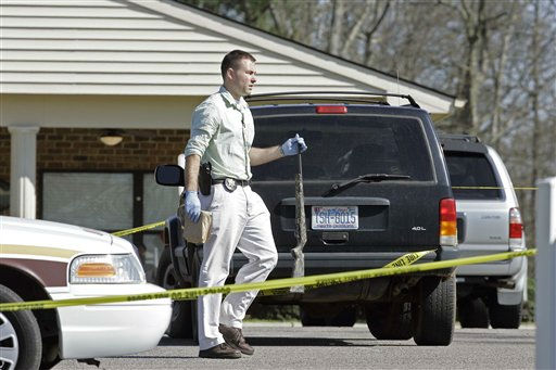 An investigator carries a weapon at the scene where a gunman opened fire at a nursing home  in Carthage, N.C., Sunday, March 29, 2009.  <span class=meta>(AP Photo&#47; Gerry Broome)</span>