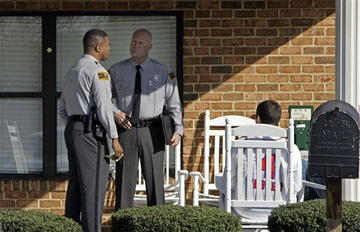North Carolina Highway Patrolmen stand near the entrance of Pinelake Health and Rehab where a gunman opened fire  in Carthage, N.C., Sunday, March 29, 2009.  <span class=meta>(AP Photo&#47; Gerry Broome)</span>