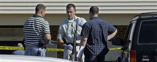 Investigators examine a weapon at the scene where a gunman opened fire at a nursing home  in Carthage, N.C. on Sunday, March 29, 2009.  <span class=meta>(AP Photo&#47; Gerry Broome)</span>