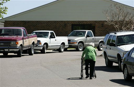 An unidentified woman walks up the drive at Pinelake Health and Rehab Center in Carthage, N.C., Monday, March 30, 2009.  <span class=meta>(AP Photo&#47; JIM R.BOUNDS)</span>