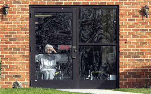 A resident pears out a door at Pinelake Health and Rehab Center in Carthage, N.C., Monday, March 30, 2009, a day after seven resident and one staff member were shot and killed.  <span class=meta>(AP Photo&#47; Jim R. Bounds)</span>