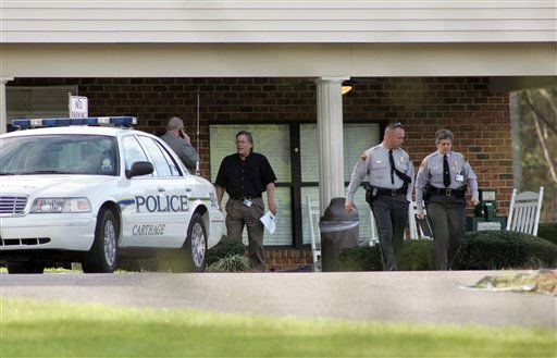 Investigators work at the scene at Pinelake Health and Rehab Center, where a gunman opened fire in Carthage , N.C. <span class=meta>(AP Photo&#47; JIM R.BOUNDS)</span>