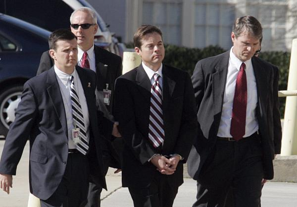 "<div class=""meta ""><span class=""caption-text "">Ruffin Poole is walked into the Terry Sanford Federal Building in Raleigh, N.C., Thursday, Jan. 28, 2010. (AP/Jim R. Bounds)</span></div>"