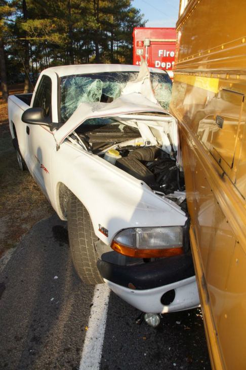 The Highway Patrol said a pickup truck driver may have been blinded by the sun when he struck a school bus on Roseland Road Thursday morning around 7:20 a.m. The truck driver, 22-year-old Suave Cain, was flown to UNC Chapel Hill Hospital. He was last listed in good condition. No one on the bus was injured. <span class=meta>(WTVD Photo&#47; Libby Staples)</span>