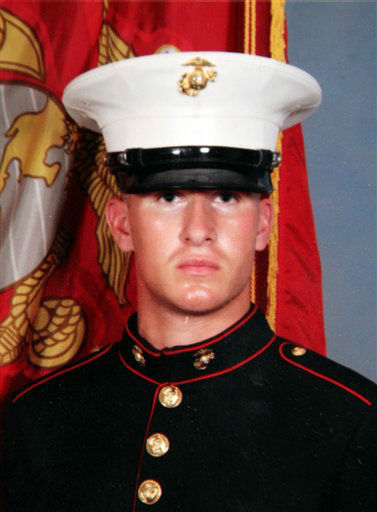 "<div class=""meta ""><span class=""caption-text "">This photos shows Marine Aaron Ripperda of Highland, Ill. Ripperda was killed with six other Marines in an explosion during a Nevada training exercise on Monday, March 18, 2013. (AP Photo)</span></div>"