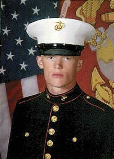 "<div class=""meta ""><span class=""caption-text "">In this undated photo released by the U.S. Marine Corps via the Marietta Times, Marine Lance Cpl. Josh Taylor poses for a photograph. Taylor 21, with the 2nd Marine Expeditionary Force from Camp Lejeune, N.C., was killed with 6 other Marines after mortar shell  exploded during a training exercise at the Hawthorne, Nev., Army Depot. (AP Photo/U.S. Marine Corps)</span></div>"