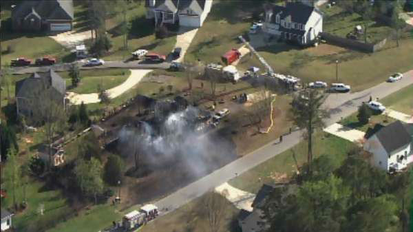 A fire destroyed a home in Lee County Wednesday afternoon. It happened at Winterwind Circle and Windjammer Court in Sanford. <span class=meta>(Photo&#47;WTVD Photo)</span>