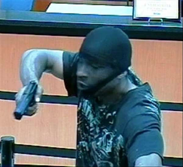 "<div class=""meta ""><span class=""caption-text "">Durham police are investigating a bank robbery that happened late Thursday afternoon at the SunTrust Bank branch in the 3400 block of Hillsborough Road. (WTVD Photo/ Durham Police Dept.)</span></div>"